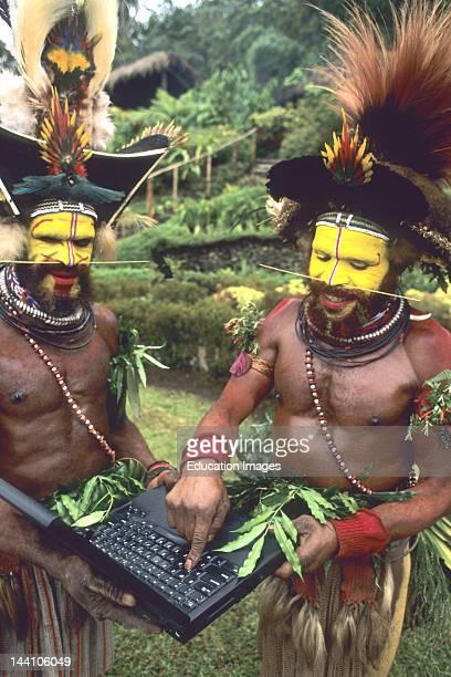 Papua New Guinea Huli Wigmen Using A Laptop