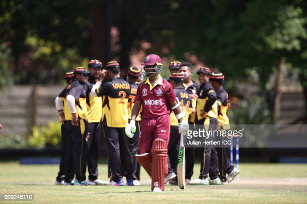 Papua New Guinea players celebrate the wicket of Jason Mohammed of The West Indies hits out during The Cricket World Cup Qualifier between The West...