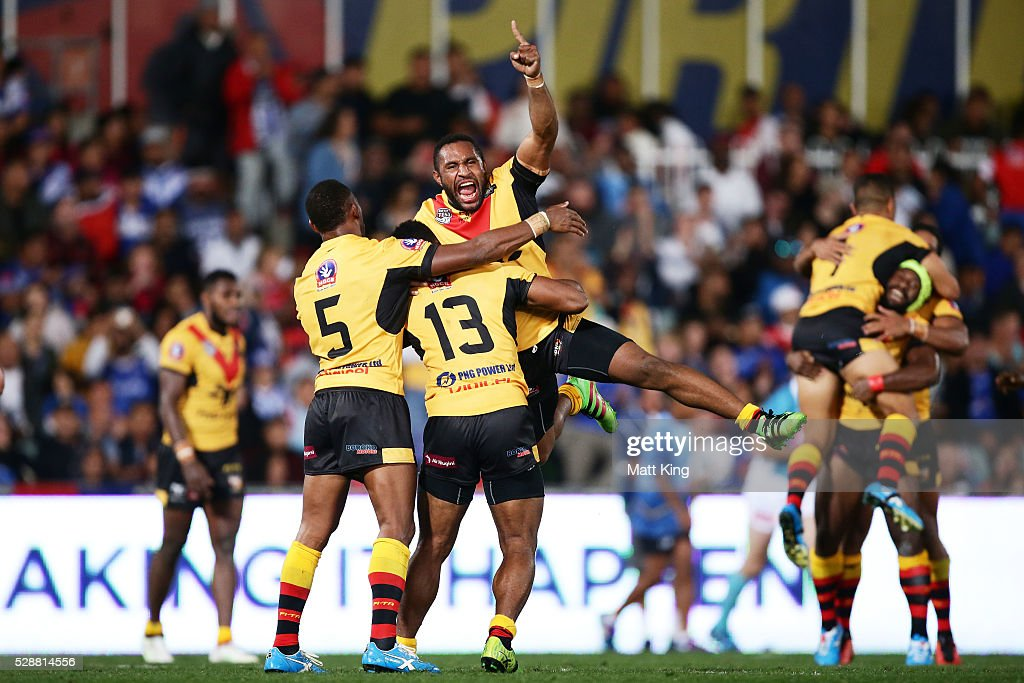 Papua New Guinea players elebrate victory at the end of the International Rugby League Test match between Fiji and Papua New Guinea at Pirtek Stadium on May 7, 2016 in Sydney, Australia.