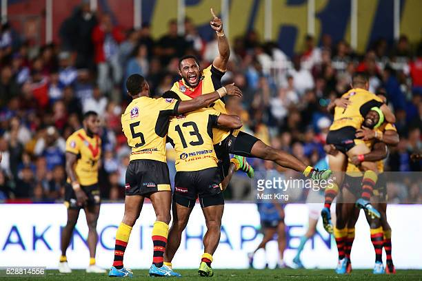 Papua New Guinea players elebrate victory at the end of the International Rugby League Test match between Fiji and Papua New Guinea at Pirtek Stadium...
