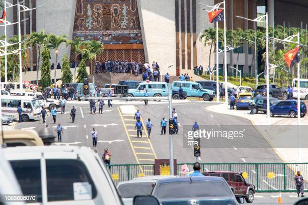 Papua New Guinea police and soldiers are pictured outside the front of the country's parliament in Port Moresby on November 20 2018 Police and...