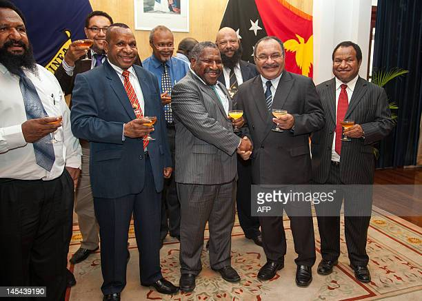 Papua New Guinea Prime Minister Peter O'Neill poses with his cabinet in Port Moresby on May 30 2012 Papua New Guinea appointed Peter O'Neill as prime...