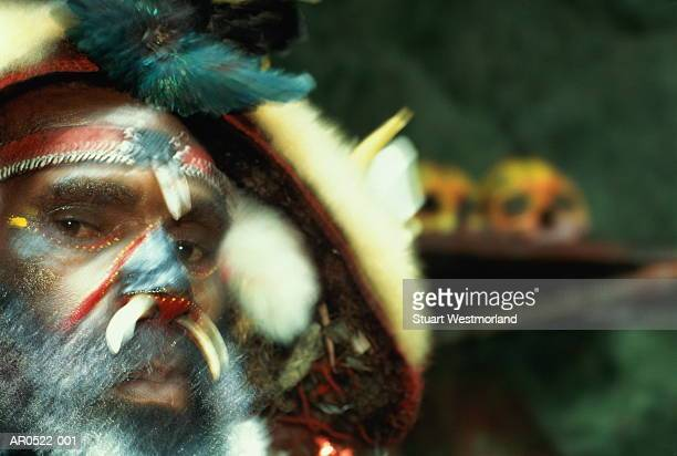 papua new guinea, tari highlands, witch-doctor (blurred motion) - tari stock pictures, royalty-free photos & images