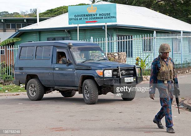 Papua New Guinean Army special forces patrol the perimeter as PNG GovernorGeneral Michael Ogio swears in PNG Prime Minister Michael Somare's cabinet...