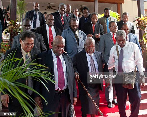 Papua New Guinean Prime Minister Michael Somare and his cabinet and ministers depart for Parliament House after they were sworn in by PNG...