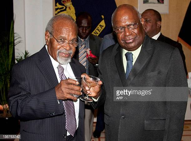 Papua New Guinean Prime Minister Michael Somare and PNG GovernorGeneral Michael Ogio toast the swearingin of Somare's cabinet and ministers at...