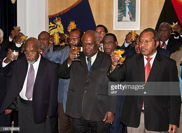 Papua New Guinean Prime Minister Michael Somare and PNG GovernorGeneral Michael Ogio toast to the health of Queen Elizabeth II after the swearingin...
