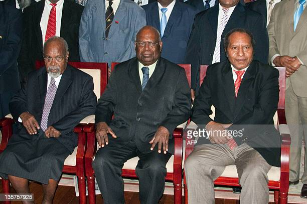 Papua New Guinean Prime Minister Michael Somare and PNG GovernorGeneral Michael Ogio pose for a photograph after the swearingin of Somare's cabinet...
