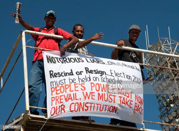 Papua New Guineans protest against the government's plan to delay national elections during a rally in Port Moresby on April 10 2012 Papua New...