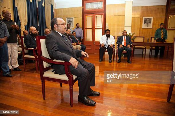 Papua New Guinea's Peter O'Neill and members of his cabinet wait for Parliament Speaker and acting GovernorGeneral Jeffrey Nape to sign documentation...