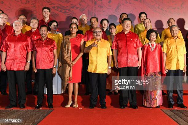 Papua New Guinea's Prime Minister Peter O'Neill gestures during a family photo with Canada's Prime Minister Justin Trudeau Chinese President Xi...