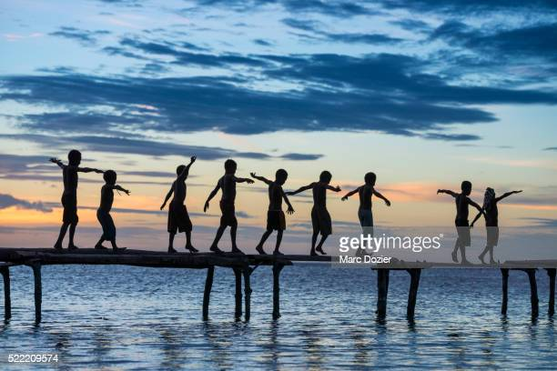 papuan children in sunset - papua new guinea stock pictures, royalty-free photos & images
