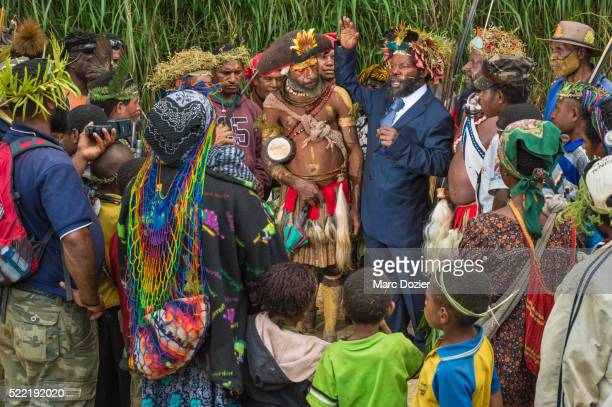papuan man wearing a suit - tari stock pictures, royalty-free photos & images