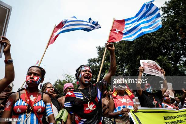 Papuan students shout slogans during a rally in Jakarta Indonesia on August 28 2019 Student and activist gathered for a protest supporting West Papua...