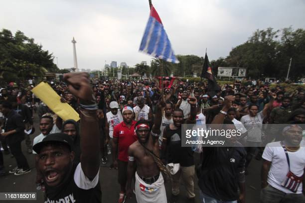 Papuan students stage a demonstration condemning racial attacks against them as a response to the raid in Papuan student's dormitory in Surabaya, in...
