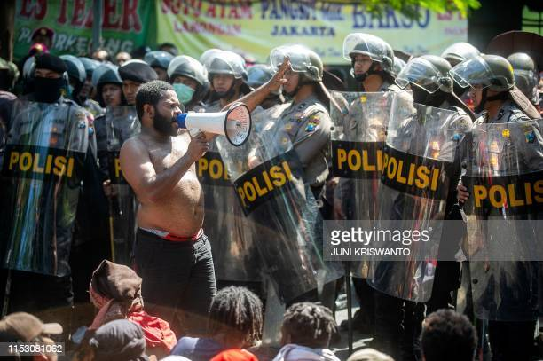 Papuan students take part in an antigovernment protest in Surabaya on July 1 2019 A lowlevel insurgency has simmered for decades in resourcerich...