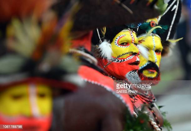 Papuan villagers clad in traditional costumes and headdresses Hela tribe perform at the airport prior to China's President Xi Jinping arrival at Port...
