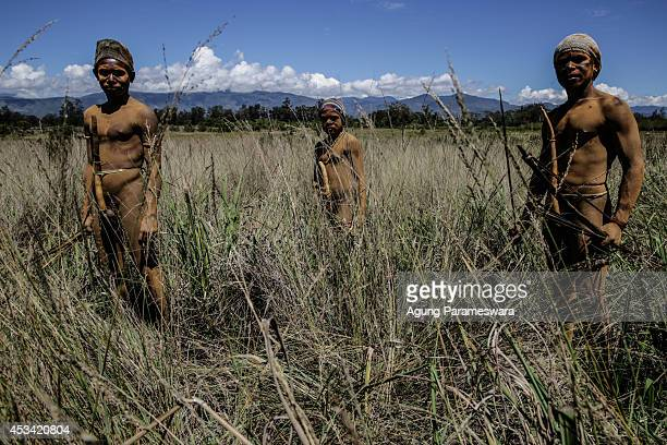 Papuanese tribal boys stand in an open field during the 25th Baliem Valley festival on August 8, 2014 in Wamena, Indonesia. The Baliem Valley...