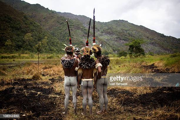 Papuanese tribal men prepare before their perform during the Baliem Valley Festival on August 10, 2010 in Wamena, Indonesia. The Dani, Yali and Lani...