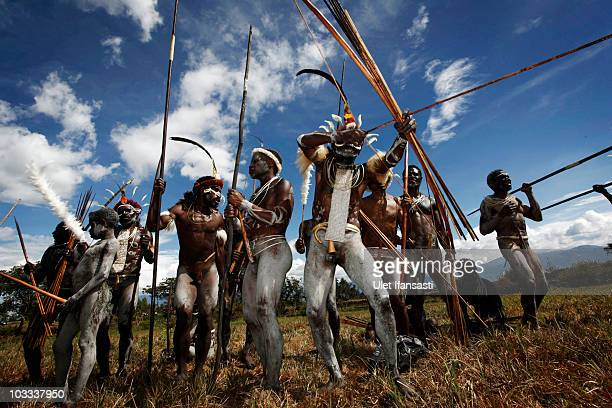 Papuanese tribal men stand with their traditional armament during the Baliem Valley Festival on August 9, 2010 in Wamena, Indonesia. The Dani, Yali...