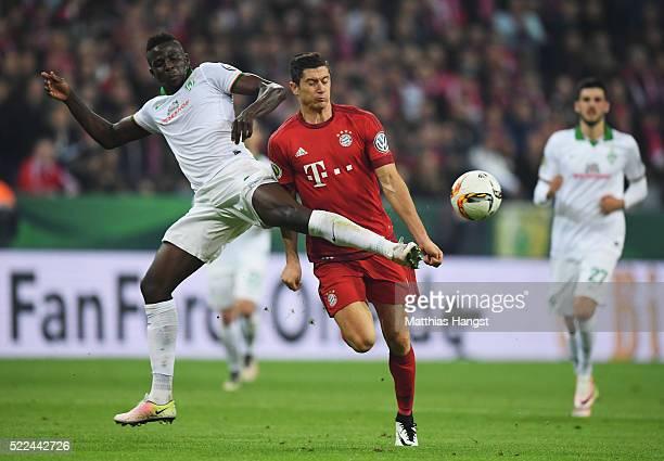 Papy Djilobodji of Bremen challenges Robert Lewandowski of Muenchen during the DFB Cup semi final match between FC Bayern Muenchen and Werder Bremen...