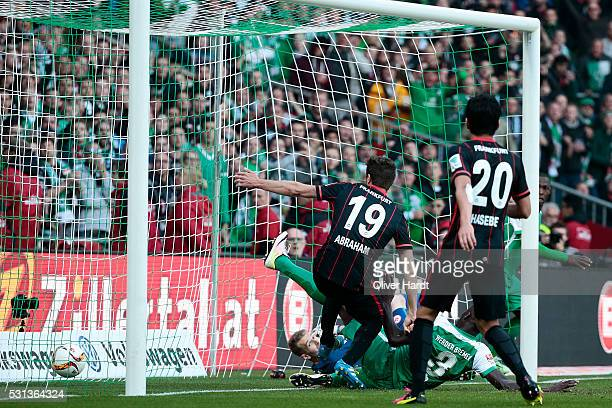 Papy Djilobodji of Bremen scores their first goal with ball during the Bundesliga match SV Werder Bremen and Eintracht Frankfurt at Weserstadion on...