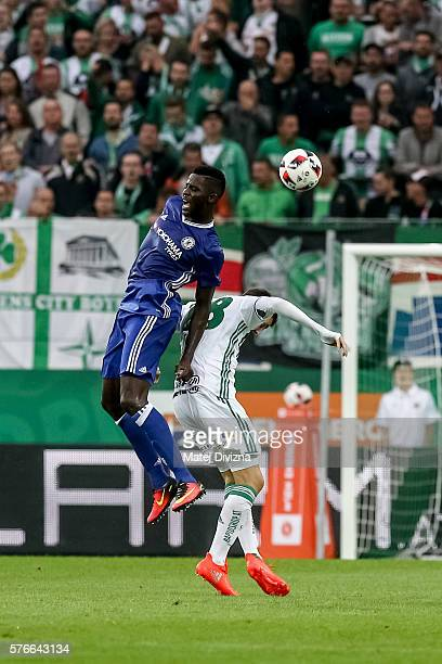 Papy Djilobodji of Chelsea competes for the ball with Tamas Szanto of Rapid Vienna during an friendly match between SK Rapid Vienna and Chelsea FC at...