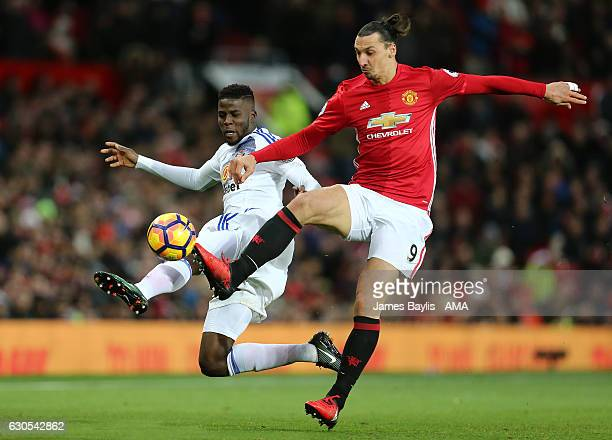 Papy Djilobodji of Sunderland battles with Zlatan Ibrahimovic of Manchester United during the Premier League match between Manchester United and...