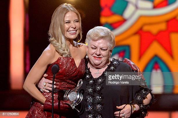 Paquita La Del Barrio accepts an award from Galilea Montijo onstage during Univision's 28th Edition of Premio Lo Nuestro A La Musica Latina on...