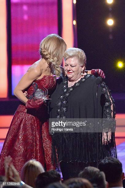 Paquita La Del Barrio accepts award from Galilea Montijo onstage during Univision's 28th Edition of Premio Lo Nuestro A La Musica Latina on February...