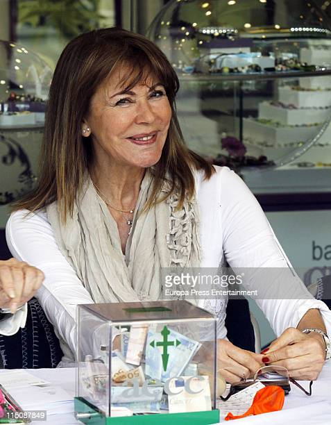 Paquita Torres presides the Real Madrid Cancer Charity Table to collect funds for the Spanish Cancer Association on June 2 2011 in Madrid Spain