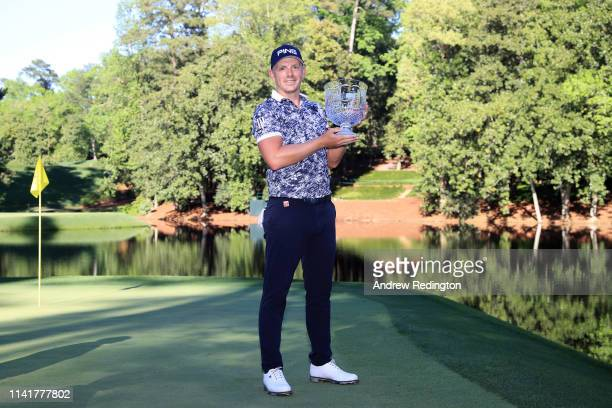 Par 3 champion Matt Wallace of England poses with the trophy after winning the Par 3 Contest prior to the Masters at Augusta National Golf Club on...