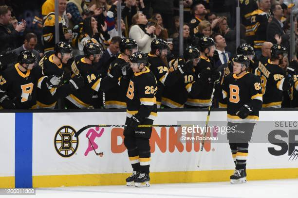 Par Lindholm and Karson Kuhlman of the Boston Bruins celebrate the goal against the Pittsburgh Penguins at the TD Garden on January 16 2020 in Boston...