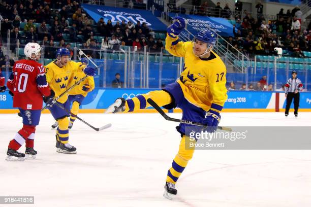 Par Lindholm of Sweden celebrates after scoring the opening goal during the Men's Ice Hockey Preliminary Round Group C game between Norway and Sweden...