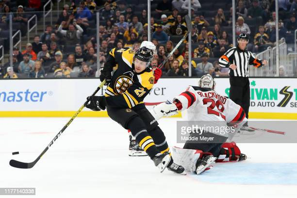 Par Lindholm of the Boston Bruins looks for a shot against Mackenzie Blackwood of the New Jersey Devils during the third period of the preseason game...