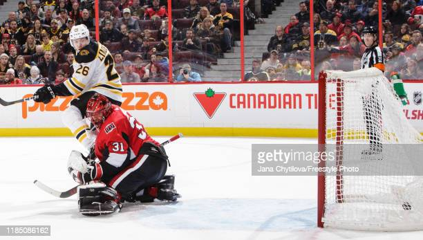 Par Lindholm of the Boston Bruins screens Anders Nilsson of the Ottawa Senators on a goal by team mate Zdeno Chara in the third period at Canadian...