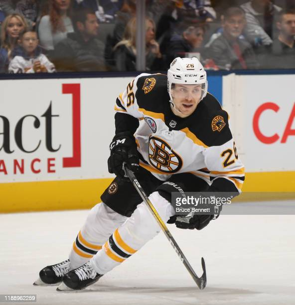 Par Lindholm of the Boston Bruins skates against the Toronto Maple Leafs at the Scotiabank Arena on November 15 2019 in Toronto Ontario Canada