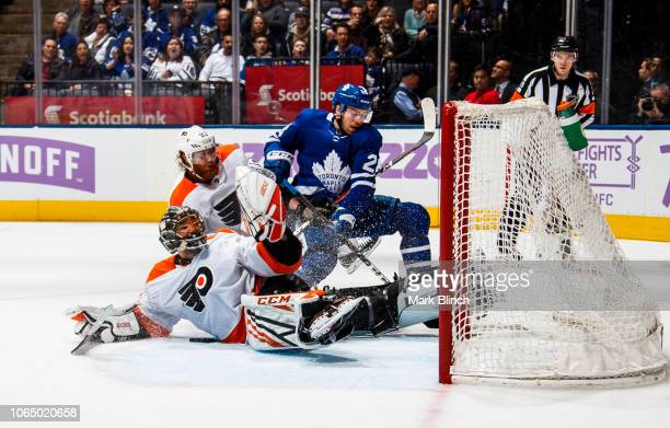 Par Lindholm of the Toronto Maple Leafs battles against Jakub Voracek of the Philadelphia Flyers and Anthony Stolarz during the third period at the...