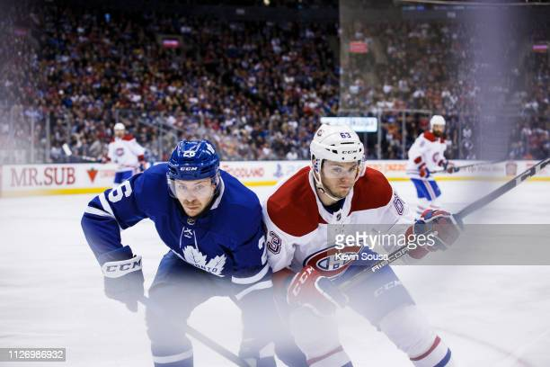 Par Lindholm of the Toronto Maple Leafs battles against Matthew Peca of the Montreal Canadiens during the first period at the Scotiabank Arena on...