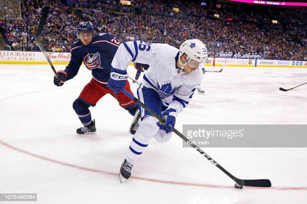 Par Lindholm of the Toronto Maple Leafs skates the puck away form Ryan Murray of the Columbus Blue Jackets during the third period on December 28...