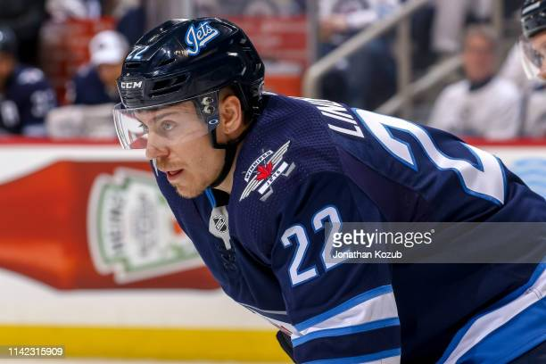 Par Lindholm of the Winnipeg Jets gets set during a first period faceoff against the St Louis Blues in Game One of the Western Conference First Round...