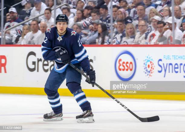 Par Lindholm of the Winnipeg Jets keeps an eye on the play during first period action against the St Louis Blues in Game One of the Western...