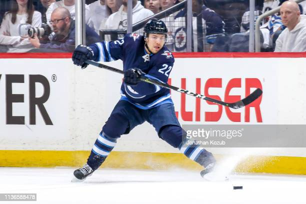 Par Lindholm of the Winnipeg Jets passes the puck during first period action against the St Louis Blues in Game Two of the Western Conference First...