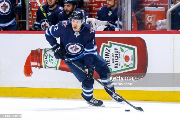 Par Lindholm of the Winnipeg Jets plays the puck up the ice during first period action against the St Louis Blues in Game Two of the Western...