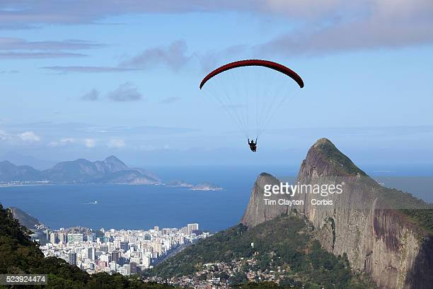 A para glider flying above the hillside of Pedro Bonita high in the hills of Rio de Janeiro Pilots of hang gliders and para gliders take tourists for...