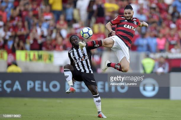 Para of Flamengo struggles for the ball with Yimmi Chara of AtleticoMG during the match between Flamengo and AtleticoMG as part of Brasileirao Series...