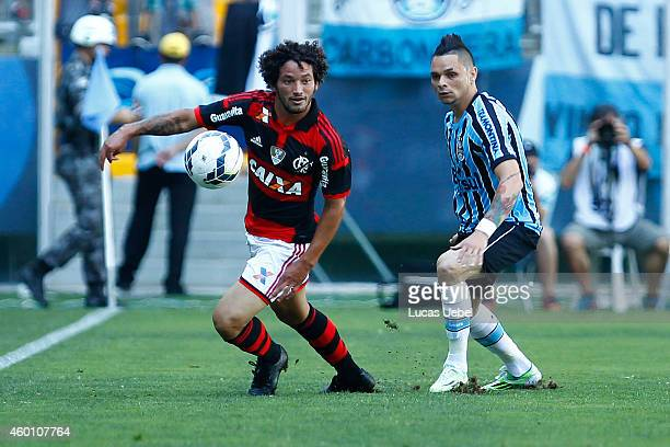 Para of Gremio battles for the ball against Arthur of Flamengo during the match Gremio v Flamengo as part of Brasileirao Series A 2014 at Arena do...