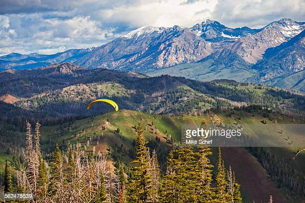 a para sailor enjoying in early morning flight. - sun valley stock pictures, royalty-free photos & images