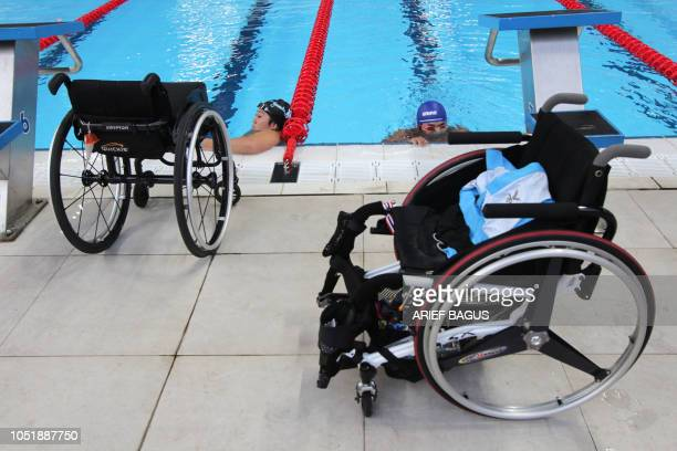Para swimmers warm up before the competition of the 2018 Asian Para Games in Jakarta on October 11 2018