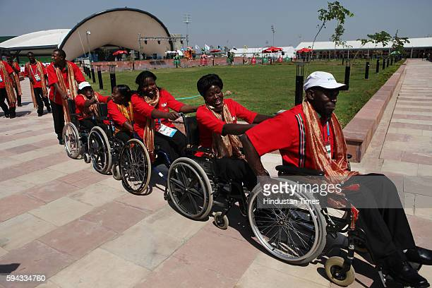 Paraathletes of the Kenya team coming to watch the flag hosting ceremony at the Commonwealth Game village in New Delhi